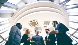 Business people talking. Group of competitive business people discussing ideas or plans Royalty Free Stock Image