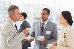 Business people talking and having coffee at a conference Royalty Free Stock Photo