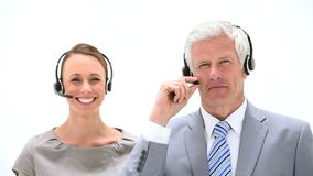 Business people talking into headset. Against white background stock video footage