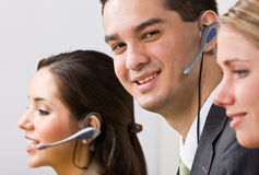 Business people talking on headsets Stock Image