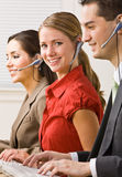 Business people talking on headsets Royalty Free Stock Photo