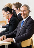 Business people talking on headsets Stock Photo