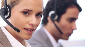 Business people talking with headsets. While sitting in an office stock footage