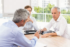 Business people talking and making arrangements Royalty Free Stock Images