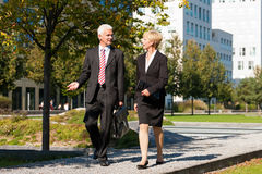 Business people talking outdoors Stock Photography