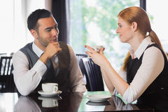Business people talking over coffee Royalty Free Stock Image