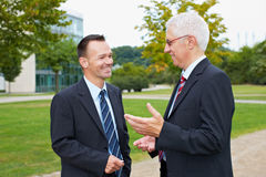 Business people talking in a park Royalty Free Stock Images