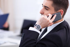 Business people talking on phone at office. Sitting at the desk Royalty Free Stock Photography