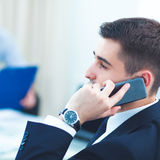 Business people talking on phone at office. Sitting at the desk Stock Photo