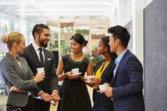 Business people talking relaxed in a group stock images