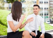 Business people talking while sitting outdoor Stock Photo