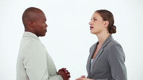 Business people talking to each other. Against a white background stock footage