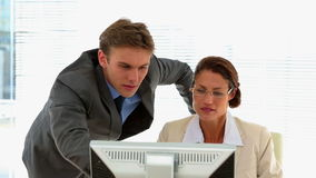 Business people talking together at desk. In the office stock footage