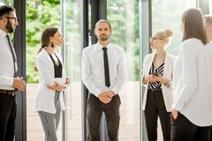 Business people talking together indoors stock photography