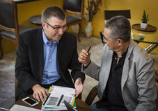 Business people talking. Two business people talking on meeting royalty free stock images