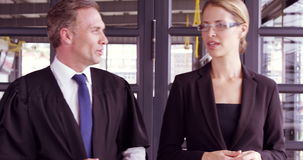 Business people talking while walking together stock footage