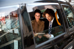Business people in taxi cab Royalty Free Stock Images
