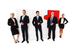Business people team. And assembled puzzle isolated on white background Royalty Free Stock Image