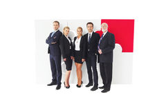 Business people team. And assembled puzzle isolated on white background Stock Images