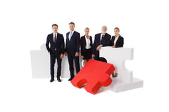 Business people team. And assembled puzzle isolated on white background Stock Photos