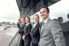 Business people team at the balcony. Business people team standing in a row at the balcony of modern office building royalty free stock photos
