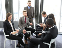 Business people team discussing together business plans. Stock Photos