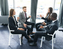 Business people team discussing together business plans. Stock Images