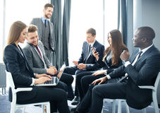 Business people team discussing together business plans. Stock Image