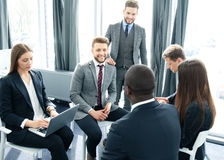 Business people team discussing together business plans. Royalty Free Stock Image