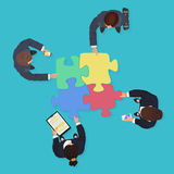 Business People team with gadgets and devices with jigsaw puzzle pieces. Finance solution concept. Royalty Free Stock Photography
