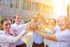 Business people team holding thumbs up royalty free stock photo