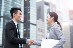 Business people team. Meeting with computer in front of the office building, shot in Hong Kong, asian Stock Images