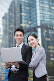 Business people team. Meeting with computer in front of the office building, shot in Hong Kong, asian stock photography