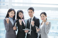 Business people team. Meeting with computer in the office, shot in Hong Kong, asian women and man royalty free stock images