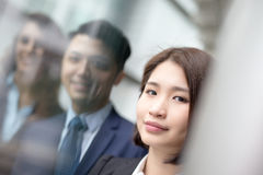Business people team. Meeting in front of the office window, asian and caucasian Stock Photography