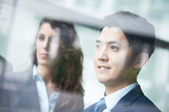 Business people team. Meeting in front of the office window, asian and caucasian Royalty Free Stock Photos