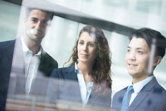 Business people team. Meeting in front of the office window, asian and caucasian Royalty Free Stock Photo