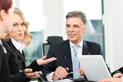 Business people - team meeting in an office stock photography