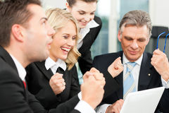 Business people - team meeting in an office. With laptop, the boss with his employees is obviously successful Royalty Free Stock Photos