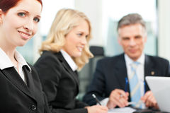 Business people - team meeting in an office royalty free stock photos