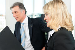 Business people - team meeting in an office. The boss with his secretary Royalty Free Stock Photography