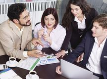 Business people in team meeting. Reviewing financial charts Royalty Free Stock Image
