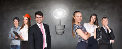 Business people team near big bulb Royalty Free Stock Photography
