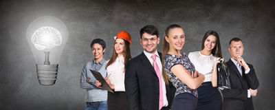 Business people team near big bulb Royalty Free Stock Image