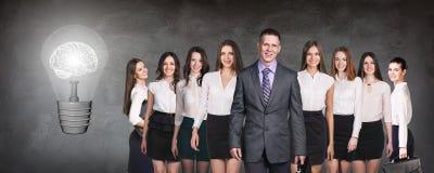 Business people team near big bulb Stock Photos