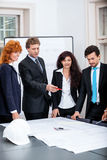 Business people team in office presentation plan Stock Photo