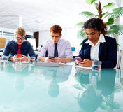 Business people team playing smartphones Royalty Free Stock Images
