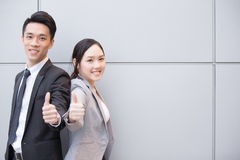 Business people team. Smile show thumb up in the office, shot in Hong Kong, asian women and man Stock Photo