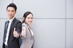 Business people team. Smile show thumb up in the office, shot in Hong Kong, asian women and man Stock Photography