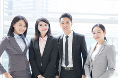 Business people team. Smile to you in the office, shot in Hong Kong, asian women and man Stock Photography